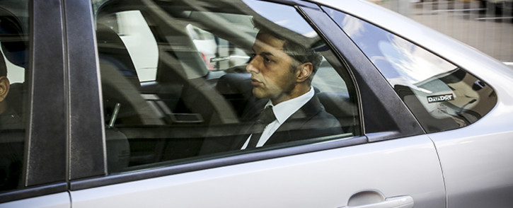 Shrien Dewani leaves court in a silver Ford Focus after another day in court.