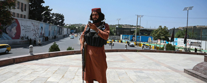 A Taliban fighter stands guard at the Massoud Square in Kabul on August 16, 2021. Picture: Wakil Kohsar / AFP