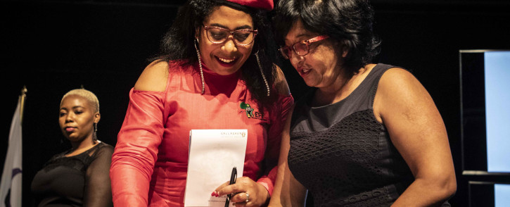 EFF's Hlengiwe Hlophe-Maxon signs the IEC code of conduct. Picture: Abigail Javier/EWN