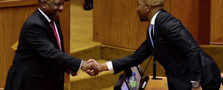President Cyril Ramaphosa shares a light moment with DA Leader Musi Maimane in the National Assembly in Parliament, Cape Town. Picture: GCIS.
