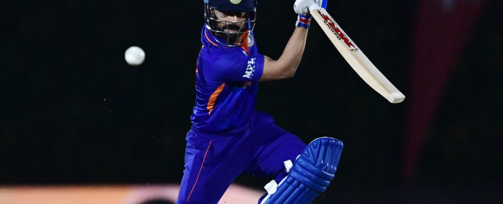 India's captain Virat Kohli plays a shot during the warmup cricket match between India and England for the ICC men's Twenty20 World Cup at the ICC Cricket Academy Ground in Dubai on 18 October 2021. Picture: AFP