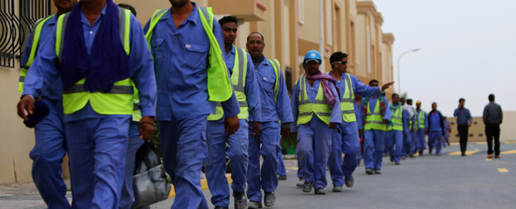 This file photo taken in May 2015 shows foreign labourers working on the construction site of the al-Wakrah football stadium, one of Qatar's 2022 World Cup stadiums. Picture: AFP.