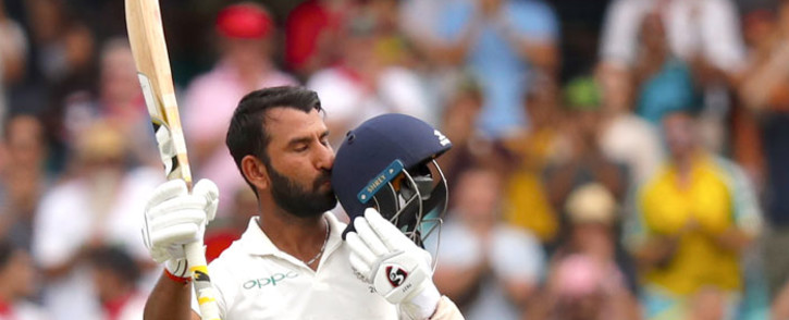 India's Cheteshwar Pujara kisses his helmet after reaching his century (100 runs) during the first day of the fourth Test against Australia at the Sydney Cricket Ground in Sydney on 3 January 2019. Picture: AFP