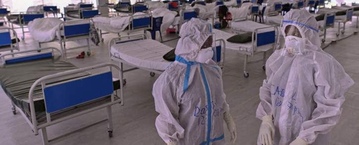 FILE: Medical staff in personal protective equipment (PPE) prepare to start their rounds in Kenyatta stadium turned into a mass isolation facility for COVID-19 patients on 3 August 2020 at Kenya's eastern town of Machakos. Picture: TONY KARUMBA/AFP
