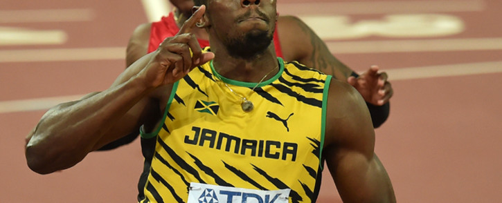 """FILE: Jamaica'€™s Usain Bolt celebrates winning the final of the men's 100m at the 2015 IAAF World Championships at the """"Bird's Nest"""" National Stadium in Beijing on 23 August, 2015. Picture: AFP"""