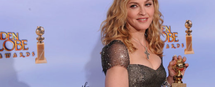 1997 Golden Globe winner; 1988, 1993, 1995, 2000, 2003 and 2012 Golden Globe nominee Madonna poses with the trophy at the 69th annual Golden Globe Awards at the Beverly Hilton Hotel in Beverly Hills, California, January 15, 2012. Picture: AFP.