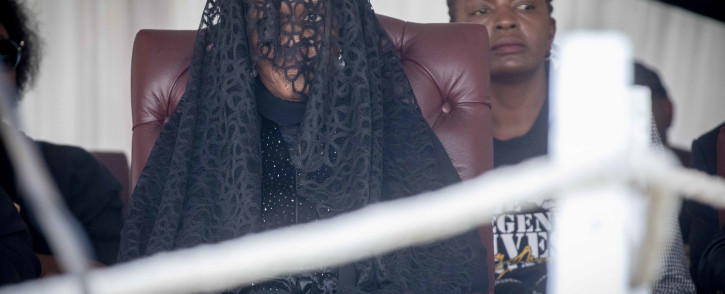 Robert Mugabe's family including his wife, Grace (veiled,) sits and watches on as members of the public view the body of the former president. Picture: Thomas Holder/EWN.