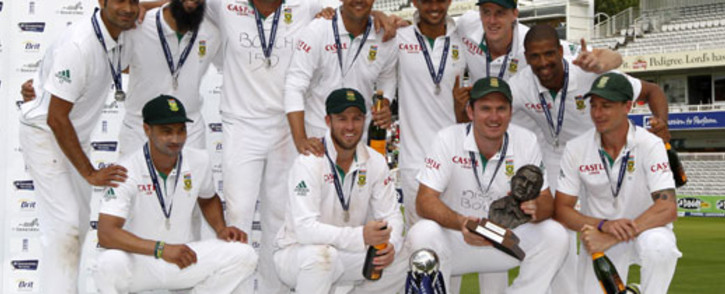 The South African team celebrates with their trophies after winning the third Test against England and securing the Test series 2-0 at Lord's cricket ground in London on August 20, 2012. South Africa replaced England as the world's number one Test side with a 51-run win in the third Test at Lord's. Picture: AFP.