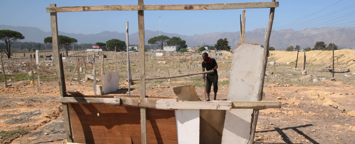 A Lwandle resident starts to build his shack near the N2 in Strand. Picture: Bertram Malgas/EWN