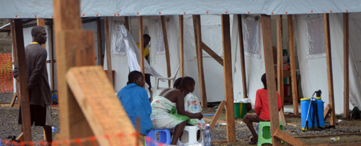FILE: Patients suffering from Ebola sit at the French NGO Medecins Sans Frontieres (Doctors without borders) Elwa hospital in Monrovia, on 21 August, 2014. Picture: AFP.