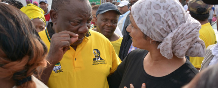 ANC President Cyril Ramaphosa talks to one of the ruling party's supporters who came out in their numbers to see the president as he campaigns for votes in Delft, Cape Town, ahead of May 2019 elections. Picture: @MYANC/Twitter