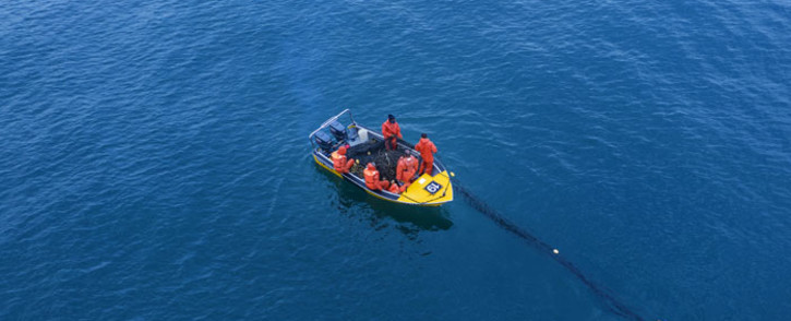FILE: An aerial view shows KwaZulu-Natal Sharks Board Maritime Centre of Excellence (KZNSB) boat crews service shark nets offshore of Amanzimtoti beach near Durban, on 11 December 2020. Picture: AFP