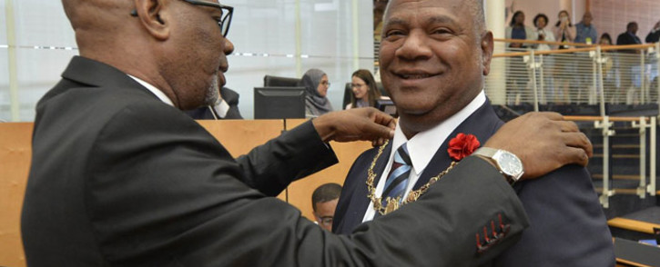 Dan Plato is presented with the City of Cape Town's mayoral chain of office. Picture: @CityofCT/Twitter