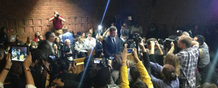 FILE: Oscar Pistorius during his court appearance at the Pretoria Magistrates Court on 19 August 2013: Picture: Barry Bateman/EWN.