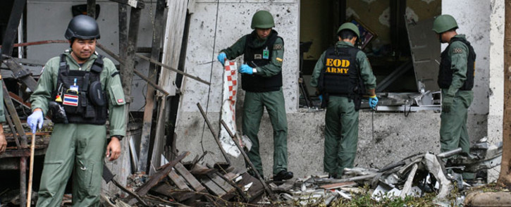 A Thai bomb squad inspects the site of a deadly bombing from the night before, in the southern province of Pattani on August 24, 2016. Picture: AFP