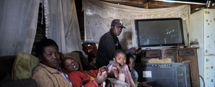Edward Mowo's family sit in their house in the Lawley informal settlement, in Lenasia, south of Johannesburg, on 17 May 2020. Edward is currently facing problems due to the lack of work during the national lockdown to help curb the spread of the coronavirus. Picture: AFP
