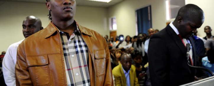 "Musician Molemo ""Jub Jub"" Maarohanye and Themba Tshabalala are seen in the dock at the Protea Magistrate's Court in Soweto on 16 October 2012, where they were found guilty of murder and attempted murder. Picture: Werner Beukes/SAPA"