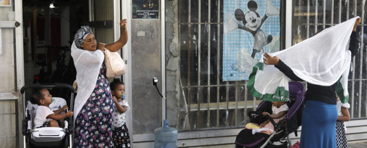 FILE: Christian African Eritrean migrants gather ahead of praying at a makeshift church in southern Tel Aviv on 2 September 2017. Picture: AFP