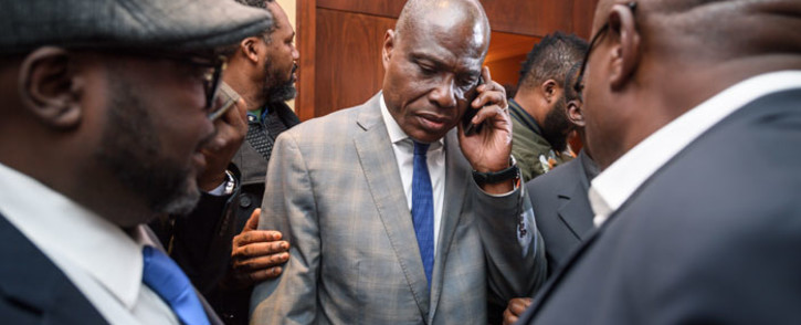 Democratic Republic of Congo joint opposition presidential candidate Martin Fayulu (C) speaks on his mobile phone following his designation on 11 November, 2018 in Geneva. Picture: AFP