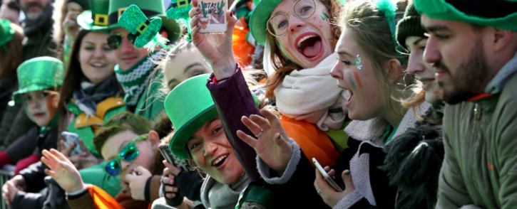 FILE: Spectators line the route during the annual St Patrick's Day parade through the city centre of Dublin on 17 March 2019. Picture: AFP