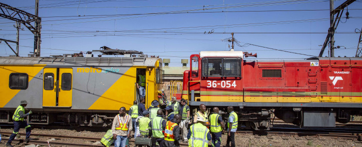 Prasa inspectors and engineers examine a train that collided with another at the Booysens station in Johannesburg. Picture: Thomas Holder/EWN