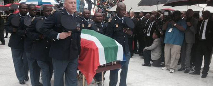 Senzo Meyiwa's body has been wheeled out of Moses Mabhida on 1 November 2014 to its burial site in Chesterville. Picture: Marc Lewis/EWN.