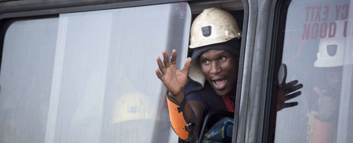 A miner waves from a window of a bus after being rescued from Sibanye-Stillwater's Beatrix mine shaft 3 on 2 February 2018. Picture: Thomas Holder/EWN
