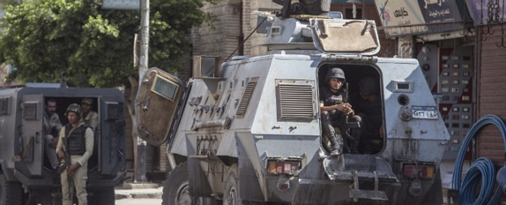 FILE: This picture taken on 26 July 2018 shows Egyptian policemen stand guarding a street in the North Sinai provincial capital of El-Arish. Picture: AFP