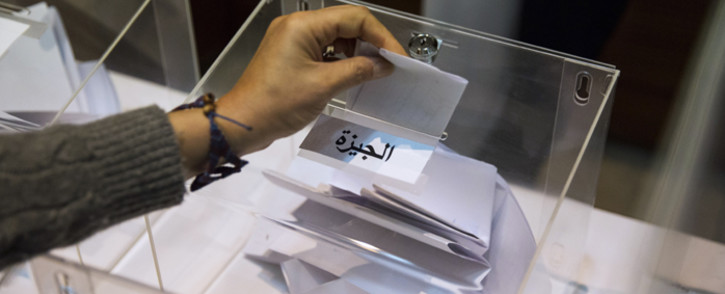 A woman casts her ballots as she votes on October 17, 2015, on the eve of Egypt's parliamentary elections at the Egyptian Embassy in central London. Egyptian voters head to the polls on October 18 with one party, the banned Muslim Brotherhood, conspicuously absent from ballot papers in the country's long-delayed parliamentary elections, the first since army chief Abdel Fattah al-Sisi ousted Islamist president Mohamed Morsi in 2013 and was elected to succeed him last year. Picture: AFP.