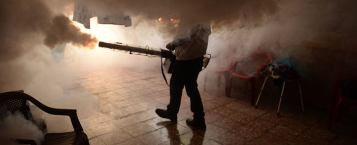 FILE: A Health Ministry employee fumigates a home against the Aedes aegypti mosquito to prevent the spread of the Zika virus. Picture: AFP.