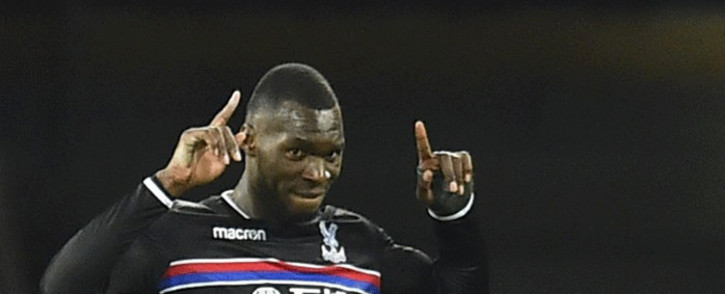 Crystal Palace's Zaire-born Belgian striker Christian Benteke celebrates scoring the opening goal during the English Premier League football match between West Ham United and Crystal Palace at The London Stadium. Picture: AFP.