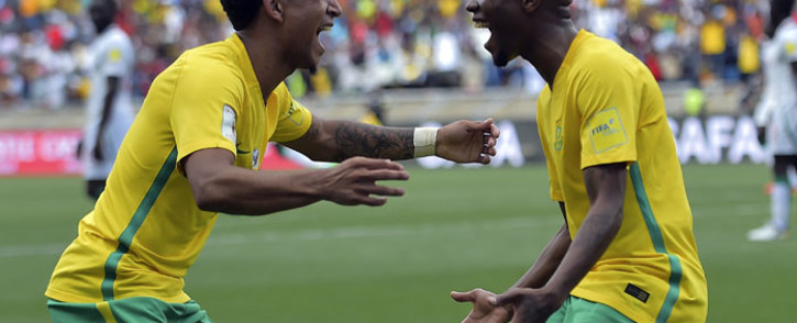 FILE: South Africa's Thulani Serero (R) celebrates with Keegan Dolly (L) after scoring a goal. Picture: AFP