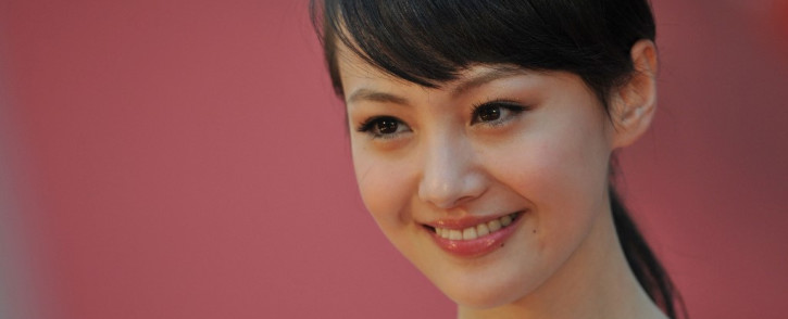 FILE: Chinese actress Zheng Shuang smiling as she walks down the red carpet at the 31st Hong Kong Film Awards in April 2012. Picture: AARON TAM/AFP