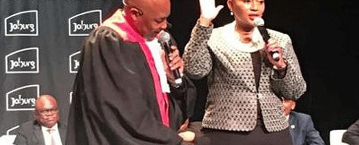 MMC Loyiso Masuku (right) takes the oath of office. Picture: @Loyiso_Masuku/Twitter