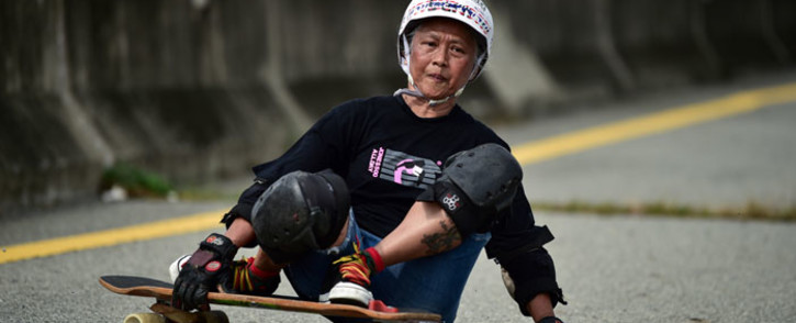 This photo taken on 9 September 2020 shows longboarder and cancer survivor Nongluck Chairuettichai, also known as Jeab, braking during a practice session in Bangkok. Picture: AFP