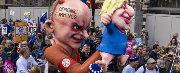 Demonstrators march with an effigy depicting Britain's Prime Minister Boris Johnson as a puppet operated by his advisor Dominic Cummings during a rally by the People's Vote organisation in central London on 19 October 2019. Picture: AFP