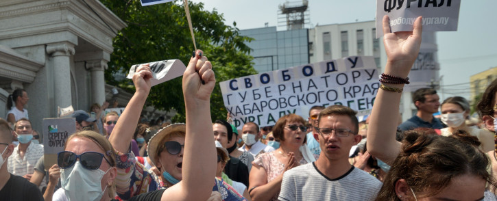 "A woman carries a placard reading ""Freedom for Furgal!"", during an unauthorised rally in support of Sergei Furgal, the governor of the Khabarovsk region who was arrested a week ago, in the Russian far eastern city of Khabarovsk on 18 July 2020. Picture: AFP"
