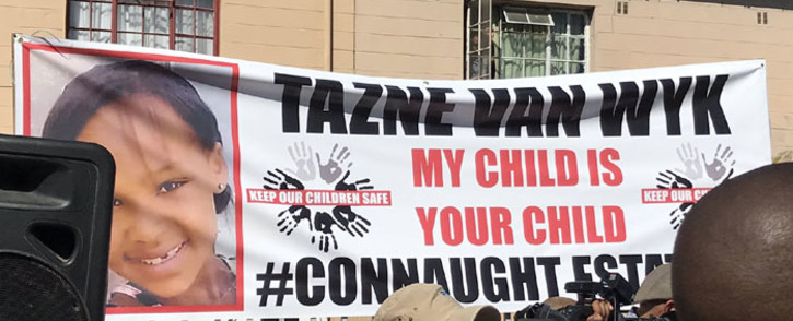 FILE: A banner outside a house in Connaught Estate where President Cyril Ramaphosa visited the family of murdered Tazne van Wyk on 26 February 2020. Picture: Kevin Brandt/EWN