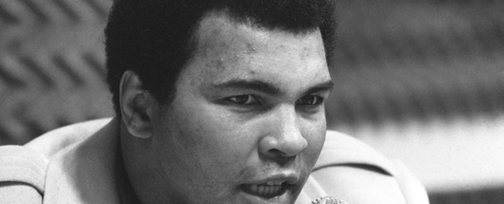 """This file photo taken on 4 March, 1976 shows heavyweight boxing world champion Muhammad Ali (Cassius Clay) during a press conference in Paris about his book """"The Greatest"""". Picture: AFP."""