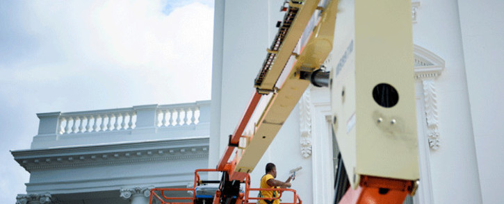 In this file photo taken on 19 September 2018, a worker paints the White House in Washington, DC. The US jobless rate tumbled in September to its lowest level since December 1969, even as job creation slowed. Picture: AFP.