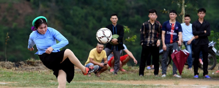 Ethnic San Chi women dressed in traditional costumes play a friendly football match as part of the Soong Co festival celebrations in northern Vietnam's Quang Ninh province on April 24, 2021. Picture: Nhac Nguyen / AFP.