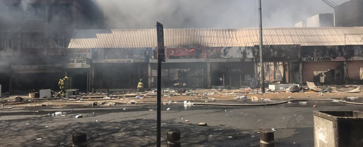 Burnt shops and buildings at the Tshwane protest in the CBD on Wednesday, 28 August 2019. Picture: Bonga Dlulane/EWN