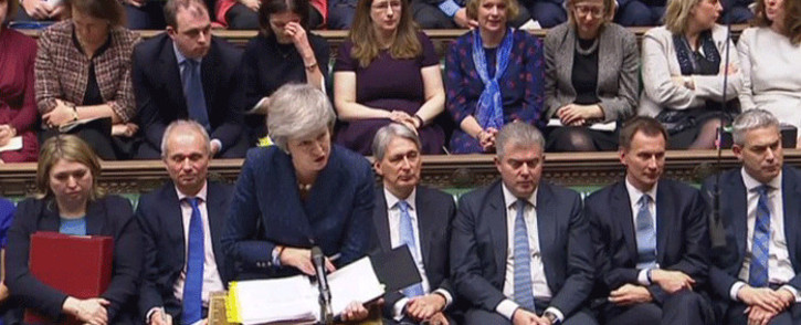 A video grab from footage broadcast by the UK Parliament's Parliamentary Recording Unit (PRU) shows Britain's Prime Minister Theresa May attending the weekly Prime Minister's Questions (PMQs) in the House of Commons in London on December 12, 2017. Picture: AFP.