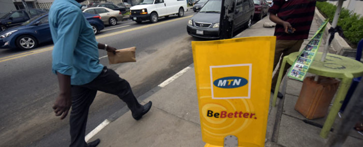 FILE: A man walks past a MTN notice board in Lagos on 27 October 2015. Picture: AFP