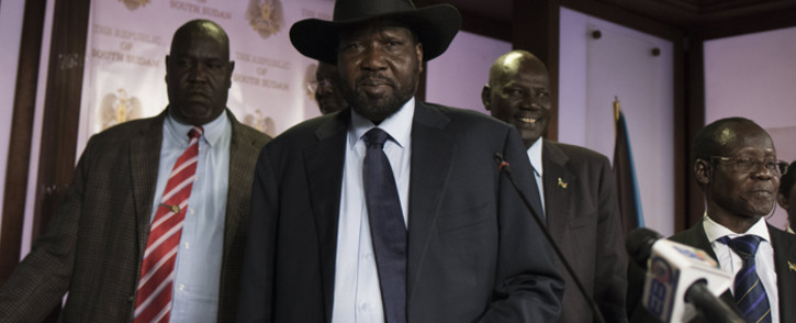 South Sudan President Salva Kiir (C), followed by Vice President James Wani Igga (2nd R), leaves the conference room as artillery fire broke out near the presidential palace in Juba on 8 July, 2016. Picture: AFP.