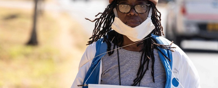 Zimbabwean novelist Tsitsi Dangarembga holds a placard during an anti-corruption protest march along Borrowdale road, on 31 July 2020 in Harare. Picture: AFP