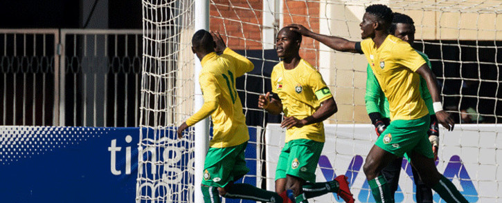 """Zimbabwe """"Warriors""""'s captain Knowledge Musona (2ndL) celebrates with teammates after scoring during their 2019 African Cup of Nations group G qualifying football match between Zimbabwe and Congo Brazaville at the National Sports stadium in Harare, on March 24, 2019. Picture: AFP."""