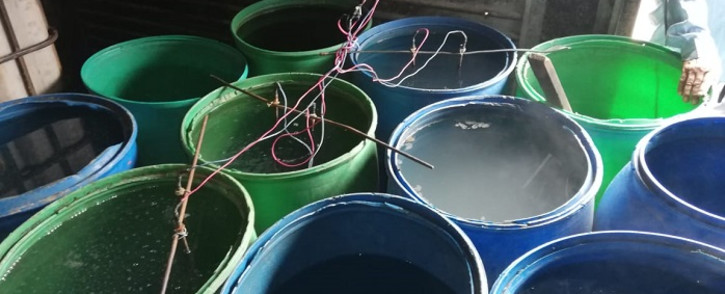 Police in the Nelson Mandela Bay metro seized thousands of litres of illegal alcohol kept at a house. Picture: SAPS.