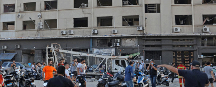 People gather near the scene of an explosion in Beirut on 4 August 2020. Picture: AFP