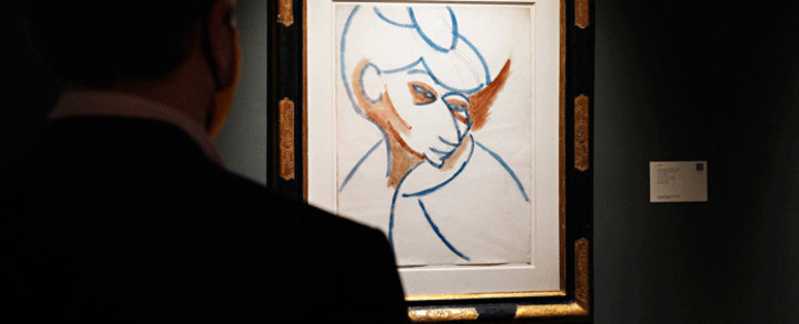 """A person looks at """"Tête de femme"""" by Pablo Picasso during a press preview of the upcoming Impressionist and Modern Art Evening Sale at Sotheby's on October 23, 2020 in New York City. Picture: Cindy Ord/Getty Images/AFP"""